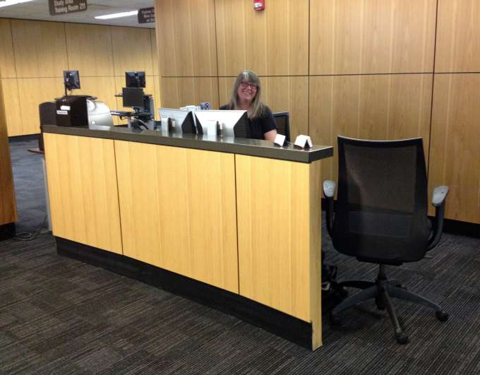 Stacey Ewing at the Research Assistance desk