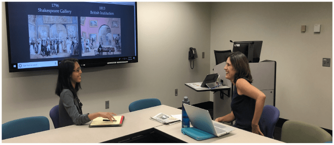 Tiffany C. Esteban consulting with Dr. Michelle Campos on a digital history project in the Library West Scott Nygren Scholars Studio.