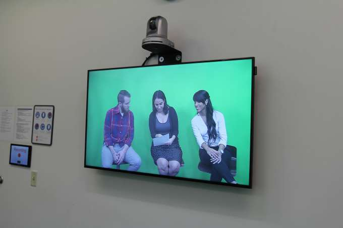 image of the confidence monitor showing three students recording themselves using the OBS system.