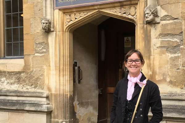 Megan Daly in front of a door in the Schools Quadrangle, Bodleian Library, Oxford